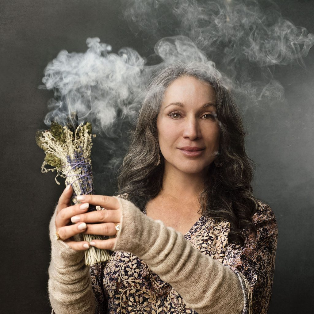 IMAGE: Zoe Helene with Spirit Bundle. Zoe's matrilineal ancestors burned Cannabis, Greek sage (Salvia fruticosa), Cedar (Cedrus libani) and Lavender (Lavandula) in spiritual healing ceremonies. Photo by Tracey Eller (@traceyeller)